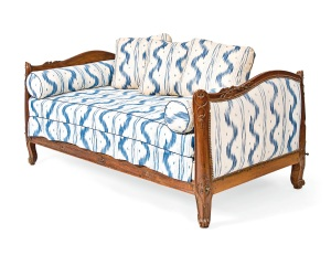 Lot 114 A LOUIS XV WALNUT LIT EN BATEAU  18TH CENTURY  Upholstered in 'toile de Vence' printed cotton by Colefax and Fowler  35 in. (88.9 cm.) high; 75 in. (190.5 cm.) wide; 43 in. (109.2 cm.) deep  Literature: For a similarly upholstered lit en bateau, see Chester Jones, Colefax & Fowler: The Best in English Interior Decoration, London, 1998, p. 104.  Estimate: £1,500 - 2,500