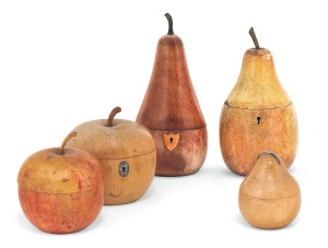 Lot 23  A COLLECTION OF FIVE FRUITWOOD TEA CADDIES  PROBABLY ENGLISH, 19TH CENTURY  Comprising: a George III apple-shaped caddy with later red-painted interior, two later pear-shaped caddies with hinged covers and two further with lift-off covers 9 in. (23 cm.) and smaller (5) Estimate: £800 - 1,200