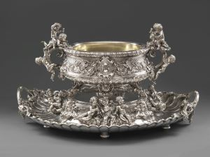 A monumental 19th century silver wine cistern and stand 19th century, French Silver Maker's mark of Sazikov (after a design by August Karl Spiess) L. 86.3 cm Koopman Rare Art, London
