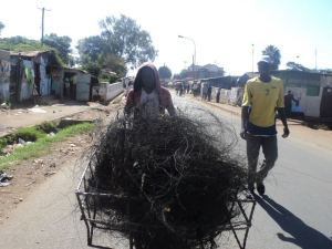 The artist Gor Soudan collecting what he calls 'Protest Wire' - remnants of burnt car tyres after the protests following the last General Election in Kenya.  WWW.ARTLABAFRICA .COM