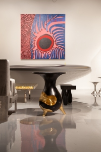 Side table 'Roots' by Mattia Bonetti, 2013. Bronze. Patinated and Gilded. Editions David Gill The painting in the background is by Kusama and the shelf is by Zaha Hadid www.davidgillgalleries.com