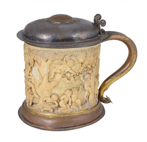 18th century tankard with ivory sleeve carved with an interpretation of 'The Element of Earth' after the original by Francesco Albani (1578-1660) depicting Cybele, Bacchus, Ceres and Flora on a chariot drawn by lions.  Esimate:  £1000-£1500