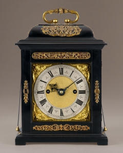 A fine James II period, ebony veneered, striking repeating bracket clock with a substantial twin fusee 8-day movement. A rare model, as few were made by Tompion with this movement. By Thomas Tompion of London Circa 1688 Ht: 12 3/8 in (31.5 cm) Provenance: This clock appears to have been in the same family for a great many generations and possibly since shortly after it was made. It is said to have been given by Queen Anne to a Miss Nicol who was a member of the Royal household and has come since by descent. If this is the case, the clock would have been some twenty years old at the time of the gift from the Queen