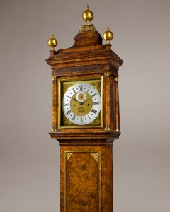 An important month duration Queen Anne period longcase clock, its magnificent case constructed principally of oak and veneered with the finest burr walnut veneers. The month duration movement is an example of Quare's finest work. Made by Daniel Quare of London. Circa 1700 Ht: 117 1/4 in (298 cm) including top finial
