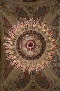 """Caliph's Staircase"" monumental chandelier, Dolmabahçe Palace, Istanbul, c. 1870. In the mid-nineteenth century, Sultan Abdülmecid began the construction of the Dolmabahçe Palace in Constantinople in order to showcase the modernity and wealth of his Ottoman Empire. Sultan Abdülaziz commissioned from Baccarat a large number of monumental chandeliers in clear and red crystal enhanced with gold, which are particularly remarkable for their bobèches in the form of stylized tulips,  the symbol of the Turkish Empire. The chandeliers were intended to furnish the Dolmabahçe Palace from the entry hall to the Blue Hall, passing by the ""Caliph's Staircase"" to arrive at the Red Chamber, the  ceremonial room of the Harem."