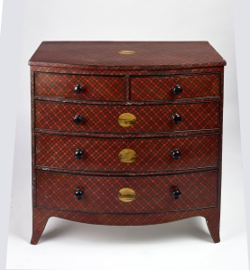 A very rare Regency bow front chest of drawers decorated in the Victorian period in tartan ware with added highland vignettes.  This type of work is normally attributed to the town of Mauchline in Ayrshire, however it is unusual if not completely unprecedented to see a piece on this scale. The town is mostly associated with tartan trinket boxes and book covers. Both the National Museum of Scotland, and the National Trust Scotland, have been shown pictures and neither has ever seen a tartan ware piece on such a scale. The largest item known to (and in fact owned by) the Museum is an occasional table/ chessboard. 101cm h x 103cm w 51cm deep For sale at £7200, Drennan Edinburgh