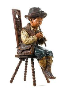 A Whimsical Statuette of a Piccolo Player By Bretby Art Pottery Dimensions: H: 31 in / 79 cm   W: 15 in / 38 cm   D: 18 in / 46 cm