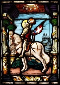 A German stained glass panel, depicting an armoured knight on horseback under a Renaissance arch, inscribed 'Zettler' lower right. F.X Zettler, Munich, 1920s 51 x 36 cm; 20 x 14 Estimate £300-400