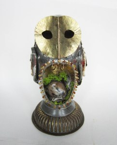 Guardian by Carola Del Mese. Antique pewter coffee pot, reclaimed metals, gold leaf, taxidermy mouse, nest materials, miniature working chandelier, glass beads. £1,200 at Fourwalls Contemporary