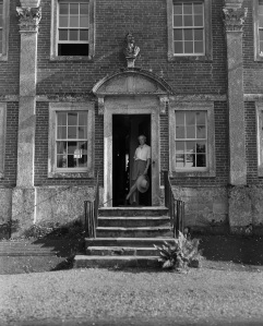 Cecil Beaton on the front steps of Reddish House, Broad Chalke, June 1947, Reddish © Cecil Beaton Archive, Sotheby's