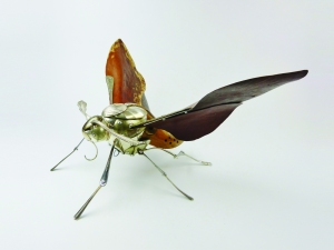 Hawk Moth by Dean Patman . Recycled materials. £1,000 at Hybrid Gallery