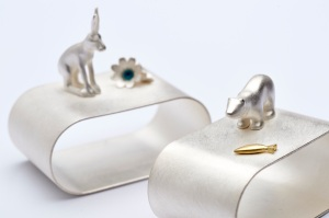 Eileen Gatt – 'Mad March Hare' and 'Arctic Supper' napkin rings in silver with gold and enamel