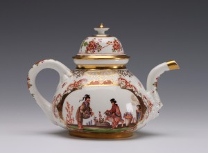 E & H Manners An Early Meissen Chinoiserie teapot and cover 1723 - 1724 K.P M. and crossed swords in underglaze blue. Height - 11.50cm The K.P.M. mark, for Königliche Porzellanmanufaktur Meissen, over a large crossed swords was introduced from December 1722 and used until 1724, it only occurs on teapots and sugar boxes.  t this early and most inventive period of chinoiserie decoration there were only about six painters employed under the direction Johann Gregorius Höroldt, attribution to a particular hand is uncertain but this type is often attributed to the hand of Philipp Schindler. The panels of chinoiseries are painted within laub und bandelwerk cartouches with panels of Böttger lustre.