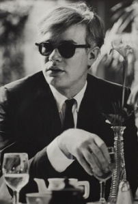 Dennis Hopper Andy Warhol (at a table) , 1963 Stamped on verso by The Hopper Art Trust Silver gelatine print 30 3/4 x 44 7/8 in 78 x 114 cm Edition of 3