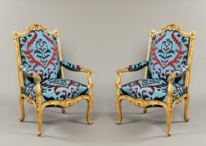 A fine pair of salon armchairs in the Régence manner by Maison Krieger of Paris, circa 1870. Dimensions H 113 cm, W 70 cm, D 60 cm. Upholstered in Bukara, a pattern of Turkoman inspiration embroidered with bulky textured yarn onto a Tussah silk ground.