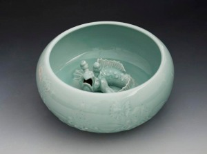 'Mudfish Bowl' porcelain modeled and carved, celadon glaze, 13cm h x 37cm across.  Photograph by Derek Au. Sladmore Contemporary
