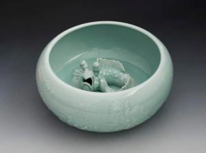'Mudfish Bowl' porcelain modeled and carved, celadon glaze, 13cm h x 37cm across.  Photograph by Derek Au. Sladmore Contemporary