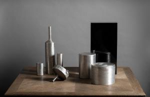 Tloupas Philolaos Ensemble of six objects, bouteilles, boîte, entonnoir et saleron, en inox (stainless-steel) ciselé. C 1960. © Mathieu Ferrier Courtesy of ALB Antiquities – Antoine Broccardo