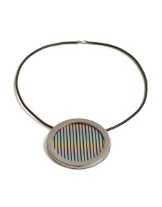 Carlos Cruz Diez Chromointerférence, 2013                  18 kt yellow gold in black rhodium, impresac acrylic with UV pigment. 6 cm diameter Edition of 10 Signed and numbered Courtesy of Elisabetta Cipriani