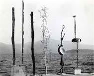 From left to right: David Smith, Forging VI, 1955, Forging VIII, 1955, Forging VII, 1955, Yellow Vertical (Construction in Three Elements), 1955, The Woman Bandit (unfinished), 1956- 58, and Construction with Forged Neck, 1955 Photograph by the artist at Bolton Landing Dock, Lake George, New York, c. 1956 © Estate of David Smith/Licensed by VAGA, New York Mnuchin Gallery, New York