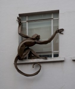 "Monkey 4 (in window). Bronze, Edition of 3. 42"" x 40"""
