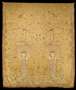 A large Chinese yellow silk embroidered wall hanging made for export to Europe. The design of two mermaids, rising from the sea and holding large bowls above their heads. The mermaids stand upright, their faces with a slightly smiling expression and framed with long curly hair extending down their backs. Flowers decorate their chests and more flowers and fruits surround them, cascading from the bowls above their heads.  The mermaid's fishy tails curve down amongst small waves carrying fish, sea monsters and rocks, while sailing boats and Chinese sanpans cross the water.  Branches of exotic fruits and  flowers spread upwards from the vessels to fill the background, accompanied by numerous butterflies, small birds and four larger birds, spied on by two small hunters, with blow pipes, hidden amongst the branches.  Chinese, for export to the West, 18th century Length: 249 cms (98 inches) Width  (excluding fringe): 211 cms (83 inches) Provenance: From a private European Collection Jacqueline Simcox