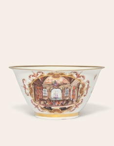 Lot 37 A MEISSEN SLOP-BOWL CIRCA 1723-24 Painted on one side with merchants and their wares in a palace interior overlooking the sea with a ship on the water beyond, the other with a procession of Turkish figures, soldiers, horses and a caparisoned elephant on the shore and a dressed barge beyond with blackamoors aboard, within oval gilt scroll-edged cartouches with Böttger-lustre panels issuing shadowed iron-red scrolls, the interior painted possibly by J.E. Stadler with an Oriental holding a fan within a similar cartouche below a gilt band border (minor chip to footrim) 6 5/8 in. (16.8 cm.) diam. Estimate 15,000 - 20,000 British pounds  CHRISTIE'S IMAGES LTD. 2014