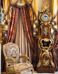 Interior view showing a magnificent Louis XV regulateur, circa 1745, formerly in the collection of the Viennese Rothschilds (estimate: £200,000-300,000, illustrated left) and one of a set of six grand Viennese giltwood armchairs with seats and backs of Beauvais tapestry depicting La Fontaine's Fables (offered over three lots each with estimates of £100,000-150,000) CHRISTIE'S IMAGES LTD. 2014