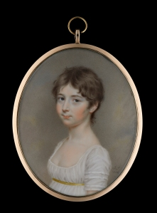 A Young Girl, possibly Miss E. Lambert, wearing a décolleté white dress with thin gold waistband, her hair worn short by John Smart.  Watercolour, gold metal frame, the reverse with central aperture glazed to reveal brown plaited hair, red leather travelling case. Signed with initials and dated 'J.S/1804'. Oval, 80mm (3 ⅛ in.) high.  © Philip Mould & Company.