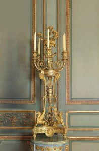 Lot 20 ONE OF A PAIR OF LATE LOUIS XVI ORMOLU SIX-LIGHT CANDELABRA ATTRIBUTED TO PIERRE GOUTHIERE CIRCA 1785-1790, POSSIBLY RETAILED BY DOMINIQUE DAGUERRE Each surmounted by a bouquet of rose stems from a flower and fruit-filled basket on a sphere-capped baluster issuing six scrolling horn-shaped branches on a circular plinth with palmette-cast frieze, the three supports headed by satyr masks and enclosing a suspended amphora to the centre, the base with griffin supports on a concave-sided tripartite base centred by Medusa masks to each side on fluted toupie feet, the rose stems late 18th century and possibly later embellishments 46 ½ in. (118 cm.) high; 16 in. (40.5 cm.) deep Estimate £350,000 - 500,000  CHRISTIE'S IMAGES LTD. 2014