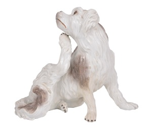 27 A MEISSEN FIGURE OF A BOLOGNESE SPANIEL, CIRCA 1743   Modelled by J. J. Kändler, free-standing, modelled seated, scratching under its chin with its hind leg, 19cm. high, restoration to right foreleg  Provenance: The Collection of Sir Gawaine and Lady Baillie; The Count Alcario Palmieri Collection, Christie's London, 28th March 1996, lot 7  £1200-1800