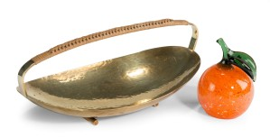 A hammered brass dish with rattan handle after Carl Auböck - Austrian circa 1950 A Murano glass orange - Italian circa 1970 L & V Art and Design