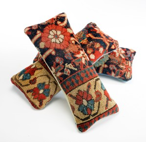 Small rug cushions, made from a vintage Mina Khani (flower pattern) rug Joshua Lumley