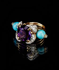 An amethyst, turquoise and diamond ring Jean Schlumberger, French Centering an oval-cut amethyst measuring approximately 14.75 x 13.90 x 10.00mm, within a pavé-set foliate surround, extending turquoise beads, enhanced by circular-cut diamonds; signed Schlumberger, with French assay marks, maker's mark and signed box. amethyst weighs approximately 11 carats; estimated total diamond weight 1.55 carats; mounted in 18k gold and platinum; size 7 1/4 US$8,000-12,000