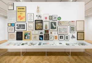 """An installation view, including Robert Mapplethorpe, Self Portrait, 1980; Jamie Reid, Large scale screen-printed promotional poster for Sex Pistols' """"Never Mind the Bollocks"""" album, 1977 and Jim Dine's Five Palettes, 1963. © ARS, NY and DACS, London 2015 © Robert Mapplethorpe Foundation. Used by permission."""