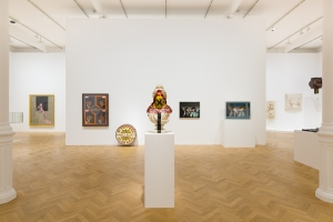 A general view, including Richard Hamilton's Swingeing London 67 (a), 1968-69 and Peter Blake's The Beatles, 1962, 1963-1968. © R. Hamilton. All Rights Reserved, DACS 2015 © Peter Blake. All rights reserved, DACS 2015.