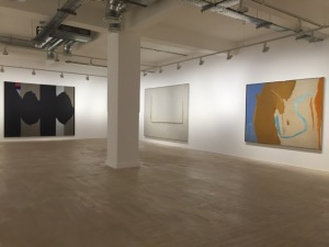 An installation view showing from the right: Motherwell, Robert California 1959 Oil and charcoal on canvas 69.75 x 89.3 inches / 177.2 x 226.8 cms; Open 22: In Charcoal with White 1968 Acrylic and charcoal on canvas 89.6 x 129.1 inches / 227.6 x 328 cms; Elegy to the Spanish Republic No .130 1974-75 Acrylic on canvas 96 x 120.5 inches / 243.8 x 304.1 cms; (C)