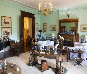The immense living room was primarily a room for entertaining. In the far left corner is Humphrey Bogart's wrought-iron and steel-inlaid slate games table, and to the left is the Mason & Hamlin ebonized grand piano where Bacall rehearsed for Broadway musicals. Guests, including Leonard Bernstein, would play at the piano during lively cocktail parties.
