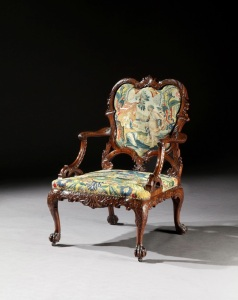 GODSON & COLES A George II period carved mahogany armchair, after a design by Thomas Chippendale.  Probably Irish, circa 1755.  H: 41.75in (106cm); W: 28.5in (72.5cm); D: 28in (71cm).