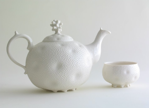 Barbara Hast,  Teapot and Cup,  porcelain, thrown, modeled, relief painting, 5.5 inches.  Courtesy of Ceramic Art London