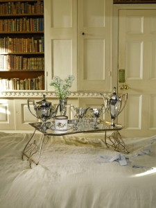 This silver-plated breakfast-in-bed tray sold for nearly 60 times over its pre-sale  high estimate ((£200-300) by to selling for £17,500. That's auctions for you!