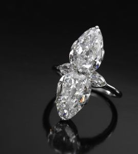 Lot 662 DIAMOND RING, CARTIER, 1930S set with two pear-shaped diamonds weighing 2.31 and 2.34 carats respectively, further accented with two marquise-shaped diamonds, size L, signed Cartier London, case stamped Cartier Paris. ESTIMATE 8,000-12,000 GBP