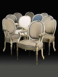 Lot 349 A SET OF NINE GEORGE III BLUE AND WHITE PAINTED ARMCHAIRS, AND ONE SIDE CHAIRCIRCA 1775, IN THE MANNER OF MAYHEW & INCE Estimate: £15,000-25,000  Although thought to have been commissioned or purchased for Crewe Hall in the 18th century several of them appear in a 1934 drawing of the State Drawing Room at Crewe House, London.