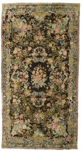 Lot 51  AN AXMINSTER CARPET, ENGLAND  Approximately 800 by 432cm; 26ft 3in., 14ft 1in. circa 1765/80  Estimate:  £50,000-80,000 Formerly in the Red Drawing Room and then later the North Drawing Room at Crewe House, London