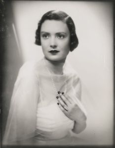 Mary Crewe-Milnes before her marriage to the Duke of Roxburghe, age 19, wearing the Cartier diamond ring (Lot 662)