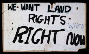 Land rights placard frm the aboriginal Tent embassy, erected, as a site of protest, in 1972.  Paint on Masonite board,  Old Parliament House, Canberra, Australia, 1972.   National Museum of Australia