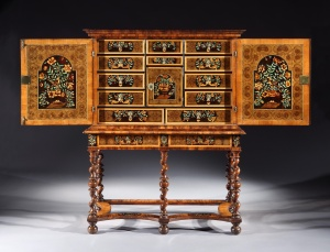 A CHARLES II OLIVE OYSTER-VENEERED AND FLORAL MARQUETRY CABINET-ON-STAND, c1685.  Rolleston