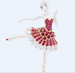 Ballerina Clip, in white gold with round diamonds, one rose-cut diamond, pink gold and round rubies. 2015. Van Cleef & Arpels