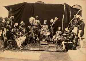 Raja Deen Dayal. The Maharaja of Bijawar, with European Chairs. Central India, circa 1882.  Albumen print, 19 x 27 cm.