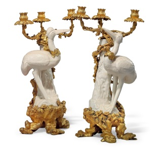 The Exceptional Sale - 2015  Christie's London, King Street, Jul 09, 2015 Lot Number 0129  PROPERTY FROM A DISTINGUISHED EUROPEAN PRIVATE COLLECTION (lots 118-131) A PAIR OF LOUIS XV ORMOLU AND GILT-COPPER-MOUNTED CHINESE BLANC DE CHINE THREE-BRANCH CANDELABRA CIRCA 1750, THE PORCELAIN EARLY 18TH CENTURY Each with a figure of a stork wearing a stylised necklace, standing before a tree trunk on a naturalistic base, mounted with twisting grape vine branches entwined around the trunk and terminating in foliate drip pans and nozzles, on a rocaille and foliate decorated base, restorations to the storks legs and the tree stumps 17 ¼ in. (44 cm.) high Estimate 300,000 - 500,000 British pounds  Provenance Possibly supplied by the marchand-mercier, Lazare Duvaux, on 14 February 1752 to Jeanne Antoinette Poisson, Marquise de Pompadour (1764) and possibly the pair listed in the 1764 inventory following her death as no. 2312. Possibly, M. l'Abbe Le Blanc, Historiographe des Batiments du Roi, sold, 14 February 1781, lot 128 and acquired by Jean-Baptiste-Pierre Lebrun, or sold anonymously (actually the properties of La Reynière, Donjeu, the marquis de Chevigné), 10 February 1773, lot 66. In the collection of Madame and Colonel Balsan in 1936, photographed in the 'salle à manger' of their Parisian hôtel overlooking the Champ-de-Mars. Thence by descent to the end of the 1950's. Sold, Sotheby's, Monaco, 11 December 1999, lot 88, where acquired by the present owner. © Christie's Images Limited 2015